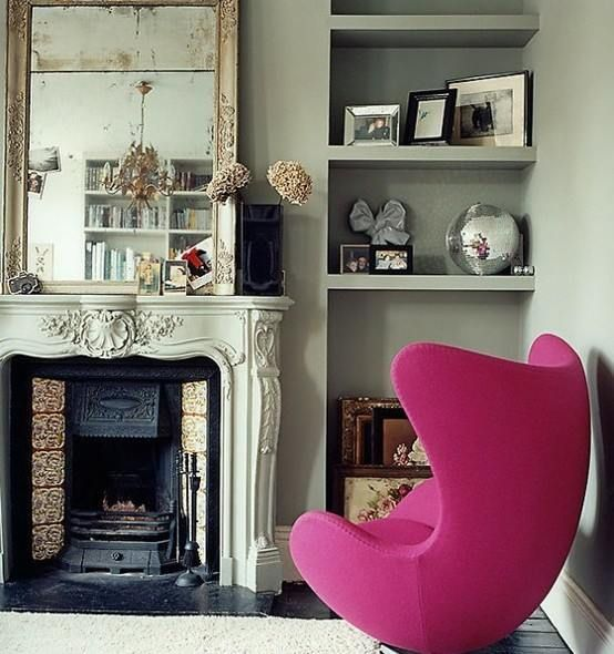 Eclectic - like the mix of modern chair and traditional fireplace. Great pop of colour too.