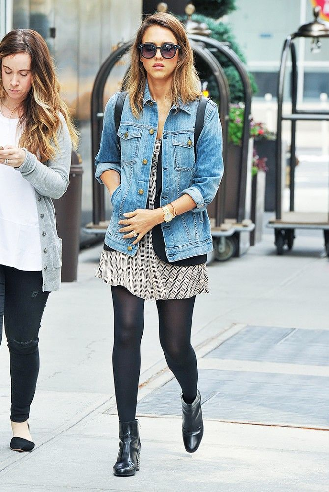 Jessica Alba wears a perfect day-or-night outfit with a denim jacket, dress, and black tights.