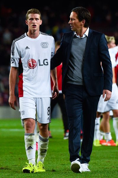 Head coach Roger Schmidt of Bayern 04 Leverkusen comforts his players Lars Bender of Bayer 04 Leverkusen at the end of the UEFA Champions League Group E match between FC Barcelona and Bayer 04 Leverkusen on September 29, 2015 in Barcelona, Catalonia.