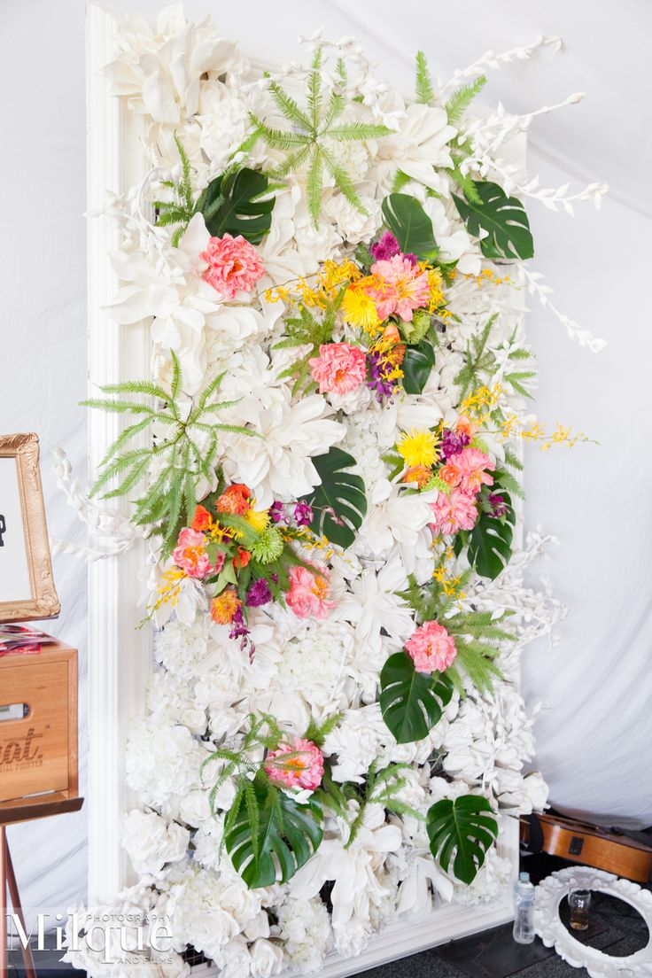 Floral and greenery photo wall at within a marquee at Melbourne Cup Raceday