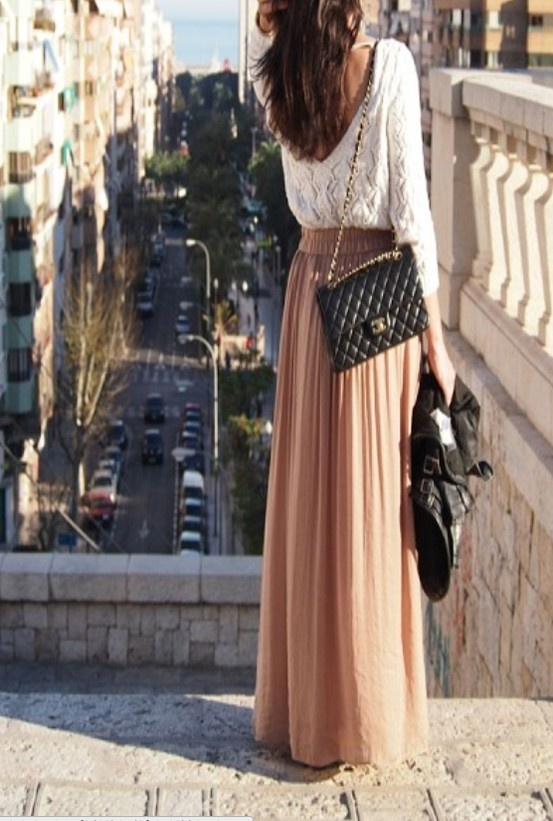 Lace top, blush maxi, leather jacket, and Chanel clutch.