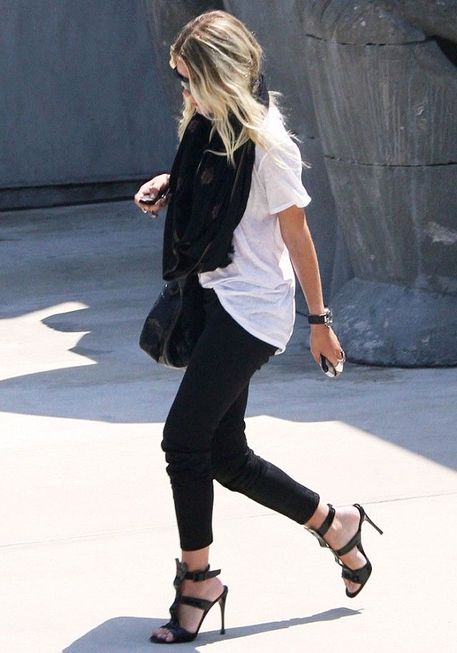 Mary-Kate Olsen wears a black scarf, t-shirt, black jeans, and strappy heels