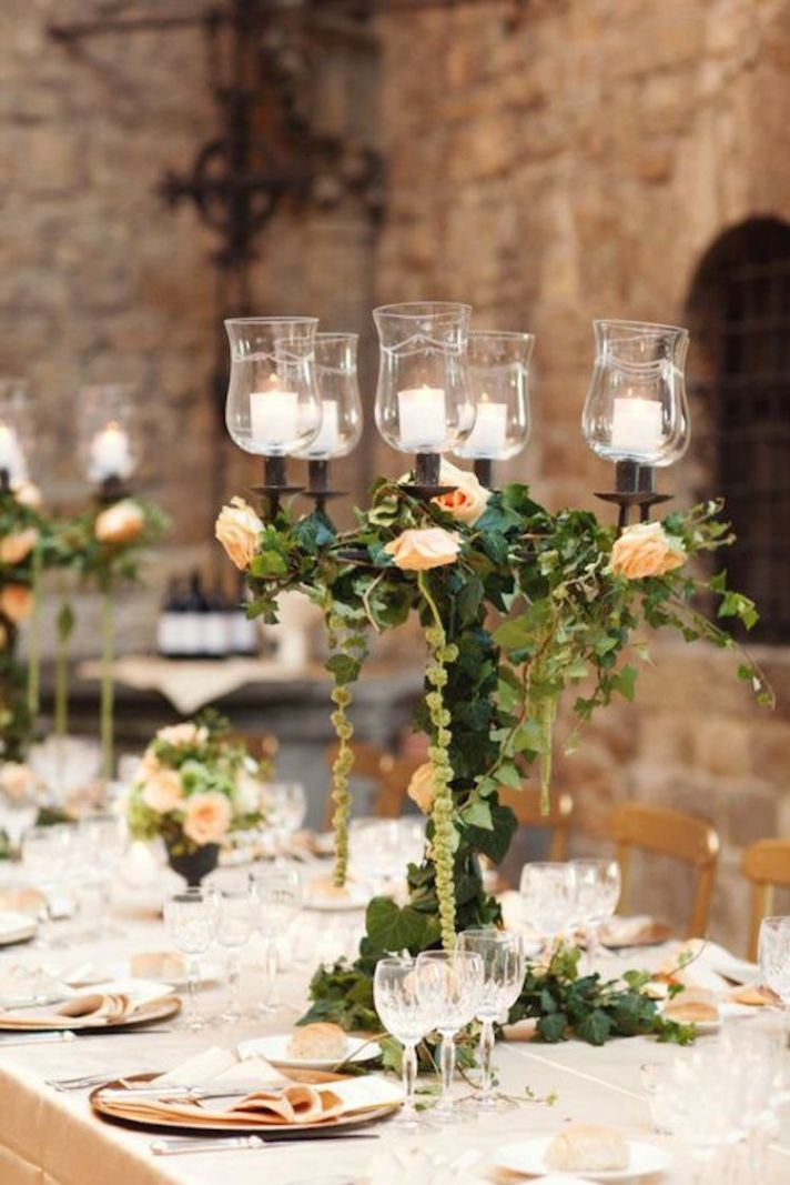 Simply Stunning Wedding Centerpieces:   Romantic Candelabra Centerpiece Covered in Foliage