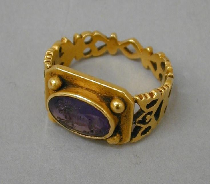 19th century gold ring with amethyst cameo (?) by Jules Wiése, France 1890