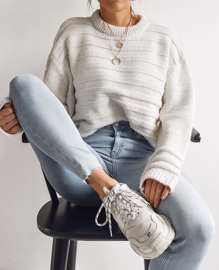Love this outfit, not sure about the sneakers. White oversized knit sweater definitely my favorite piece to have in closet + light high waisted jeans.   casual and comfy outfit ideas   everyday casual outfit inspiration for school or going out   fall   winter   #falloutfit #casualoutfit #knitsweater #oversizedsweater #knitwear #denim #jeans #comfyoutfit #whitesweater