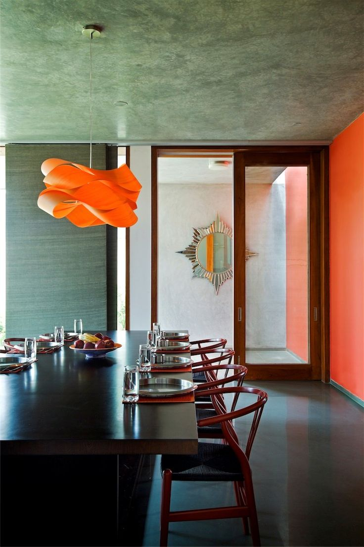 Khosla Associates India Modern House Wooden Dining Table And Chairs Orange Pendant Light Walls Glass Doors Stunning Library