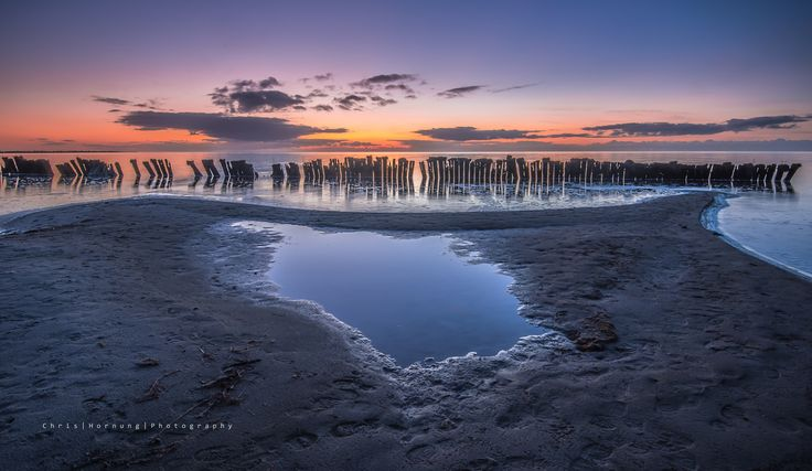 Ten minutes after sunset IJsselmeer (lake) near Hindeloopen, Friesland. Dutch Waterscape.