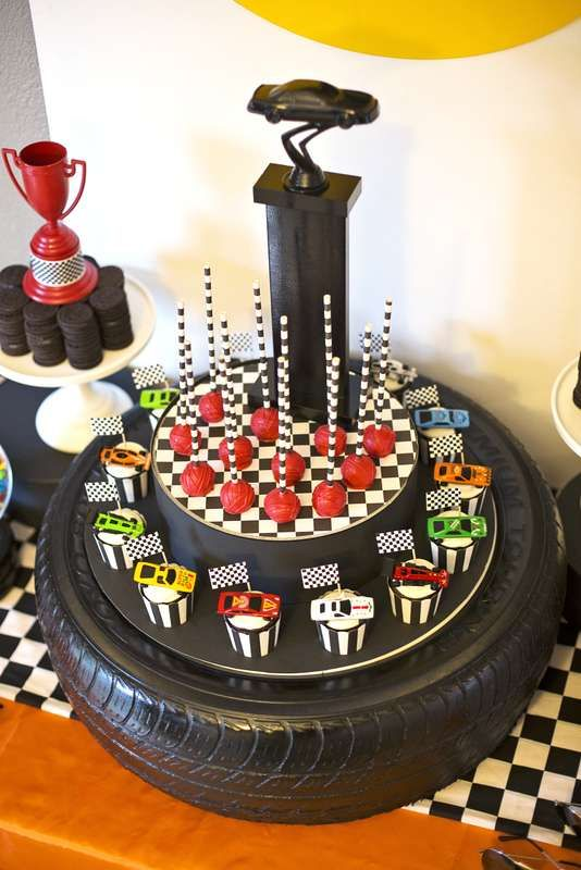 Race car birthday party cupcakes and cake pops! See more party planning ideas at CatchMyParty.com!