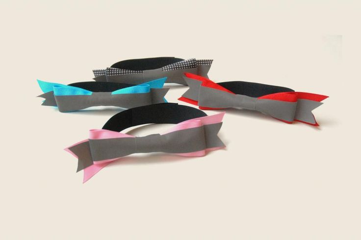 """So cool: This bow with reflector strip attaches to a bike helmet to """"dress it up"""" and keep it safe"""
