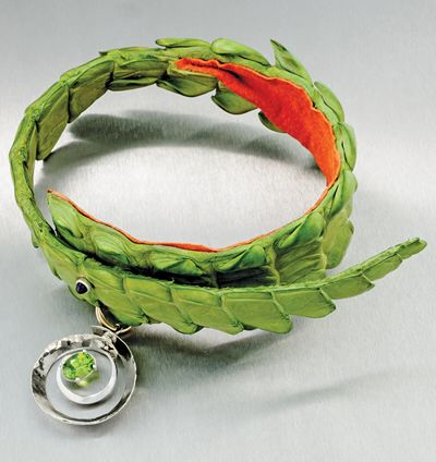 Abram Mathabatha made this collar with platinum pendant and peridot