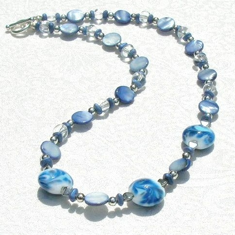 Blue Duchess - $30.00 - Beautiful murano necklace! White opaque lentil murano, lampworked in blue, paired with blue mother-of-pearl beads. Sterling silver-plated toggle clasp. Approximate finished length: 18 inches. #necklace #jewelry #beads #beadednecklace