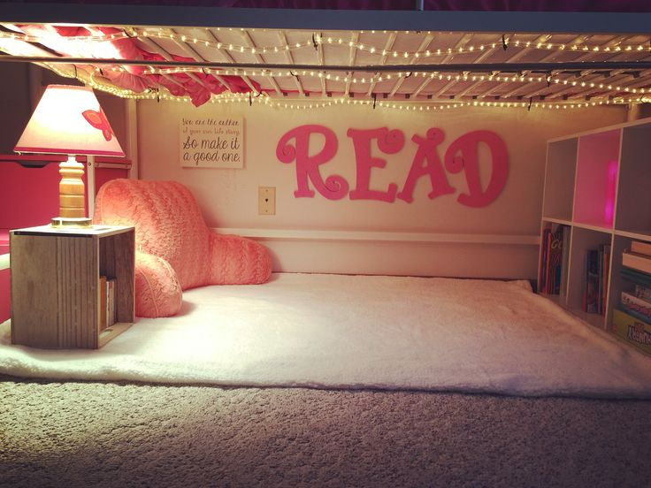 """Created a cute little """"Reading Nook"""" under my daughter's loft bed, complete with a curtain to close."""