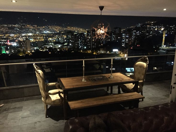 Dinner table with Medellin city In the back
