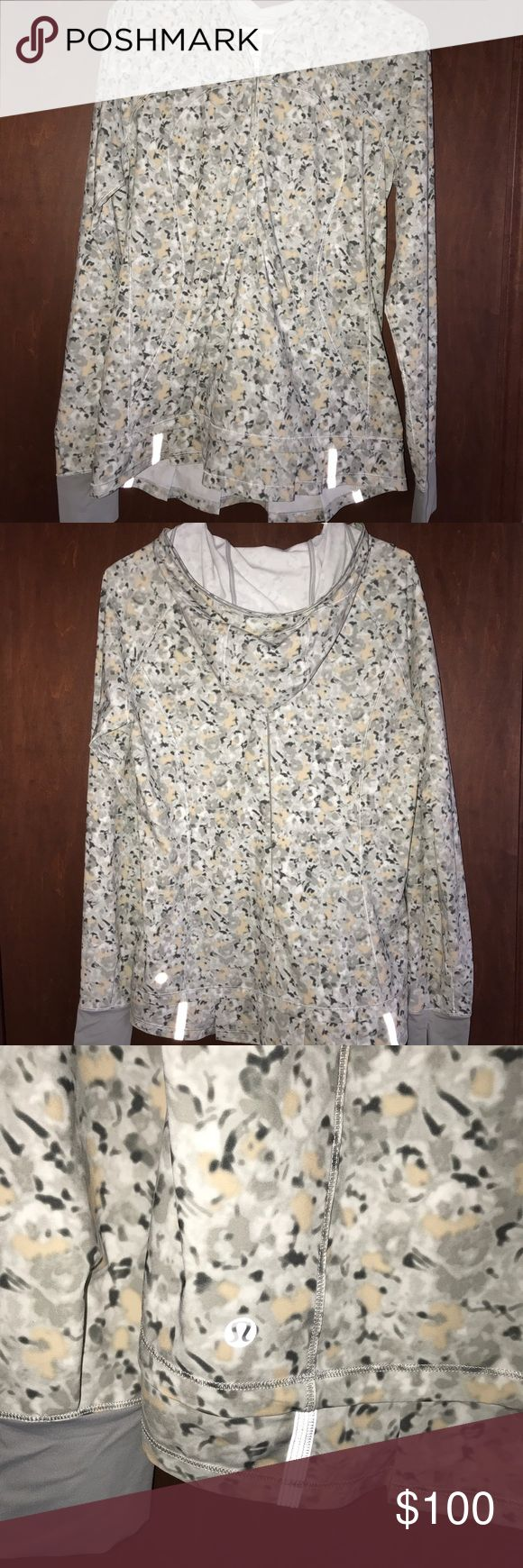 PRICE REDUCTION Lululemon Rain Resistant Pullover Beautiful and Rare pattern! Rain resistant Pullover with ruffle hem on bottom.  Flattering and perfect to layer underneath.  The hood does have a slot for your pony tail. Zero flaws! lululemon athletica Jackets & Coats