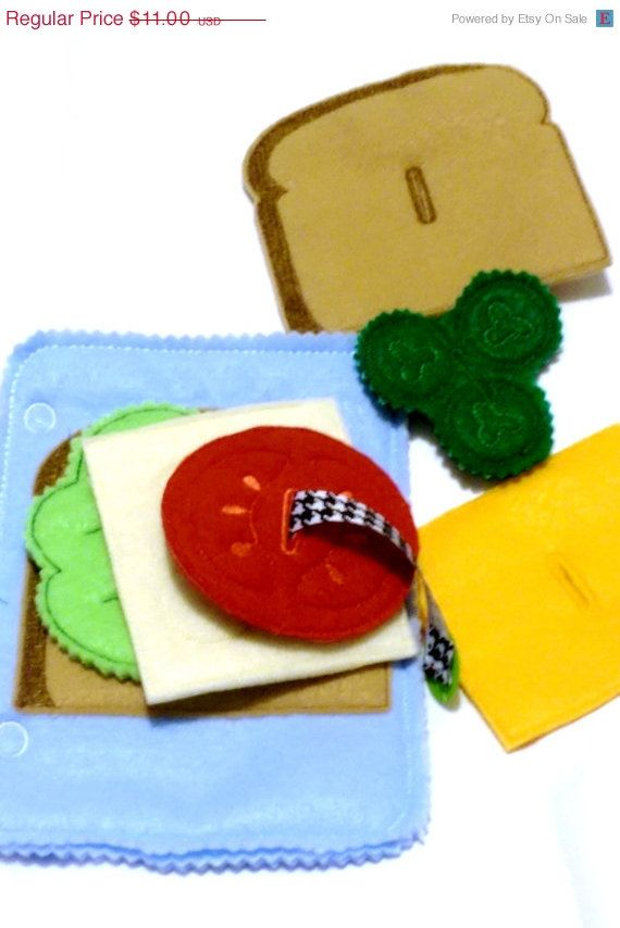 Quiet book addon page Button sandwich. Build a sandwich while practicing buttoning skills.  Page comes with a piece of bread sewn onto the mat,