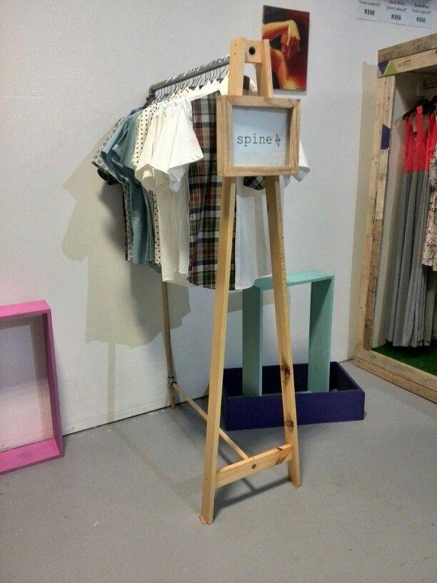 Clothing rail made of recycled Scandinavian Pine, plumbing fixtures, dowel and metal poles.