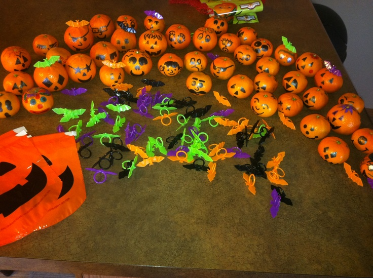 Clementines turned into jack-o-lanterns.  Cute healthy Halloween treat.