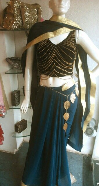 Navy blue Velvet chain blouse and crepe saree with gold border by Monicca Chopra.