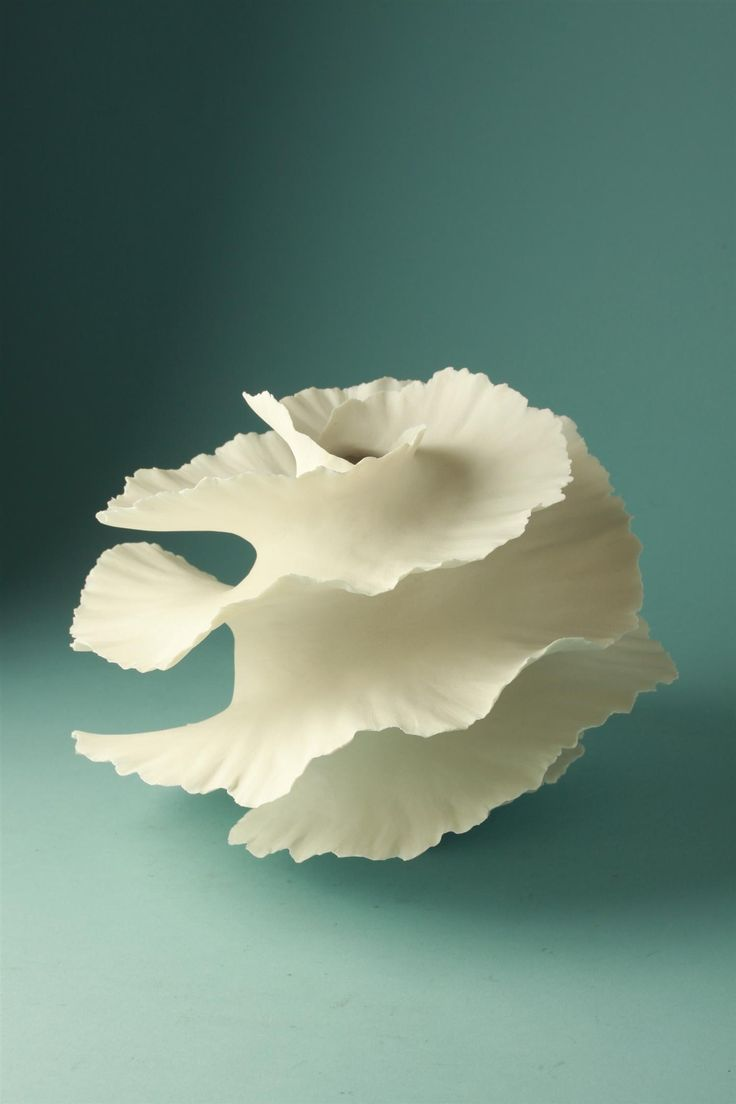 Vase by Copenhagen-based Italian ceramic artist Sandra Davolio (b.1951). Porcelain, 7.5 x 8.5 in. via Modernity.
