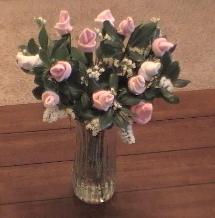 How to make Baby Sock rose instructions given to you with easy instructions & pictures! Make a beautiful baby sock bouquet for that special mother - these baby sock flower bouquets look gorgeous!