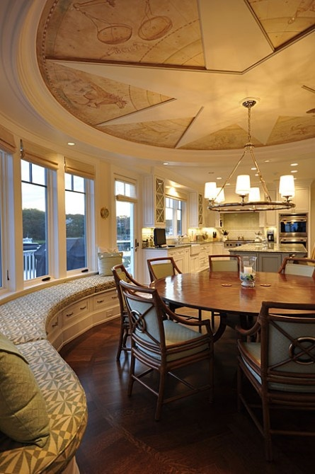 Look at that ceiling! Terrific, curved window seating in this huge dining space.