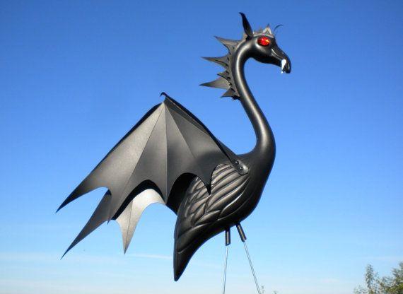 Vampire Bat Flamingo -handmade outdoor garden art sculpture created from a recycled plastic flamingo.