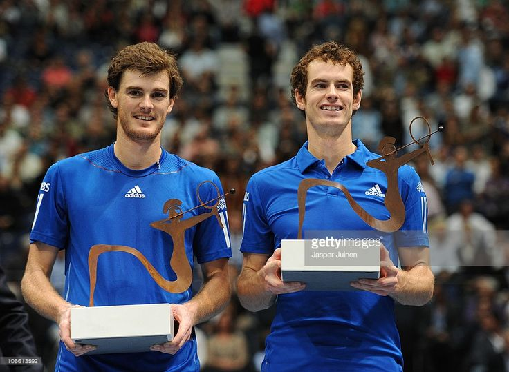 Andy Murray (R) and Jamie Murray of Great Britain pose with the doubles winners trophy after the doubles final match of the ATP 500 World Tour Valencia Open tennis tournament between the Murray brothers and Mahesh Bhupathi of India and Max Mirnyi of Belarus at the Ciudad de las Artes y las Ciencias on November 7, 2010 in Valencia, Spain.