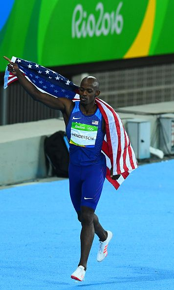 USA's Jeff Henderson celebrates after he won the Men's Long Jump Final during…