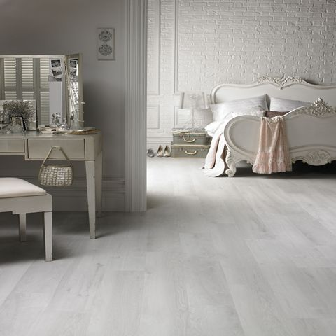 White laminate flooring from Lowes - white flooring is staple for shabby chic look