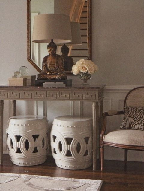 Grey Asian-inspired foyer with Buddha lamp and Chinese garden stools. Designed by Brooke Crew of Interieurs Dovecote.