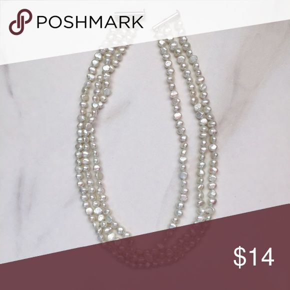 Beautiful three strand real pearl necklace Real three strand pearl necklace with silver closure. The pearls are dyed a soft bluish green. This is a timeless piece that you can wear with tees to formal dresses. Jewelry Necklaces