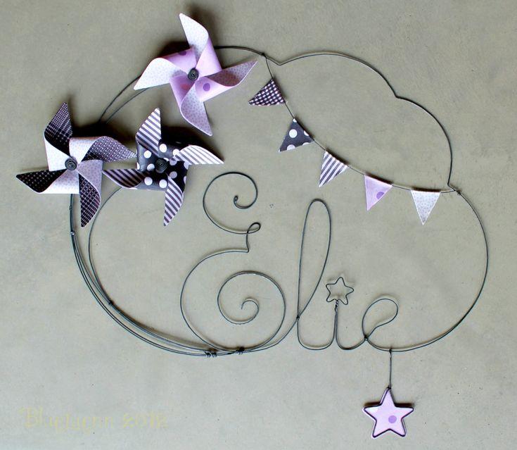 Moulins et fanions, des tons parme, violet et gris : c'est pour Elie.