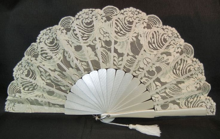 Fan is made of Sapan wood with dainty carvings, finished with silk lace, light ivory color with tassel. Can also be used for bridesmaids and other special occasions.