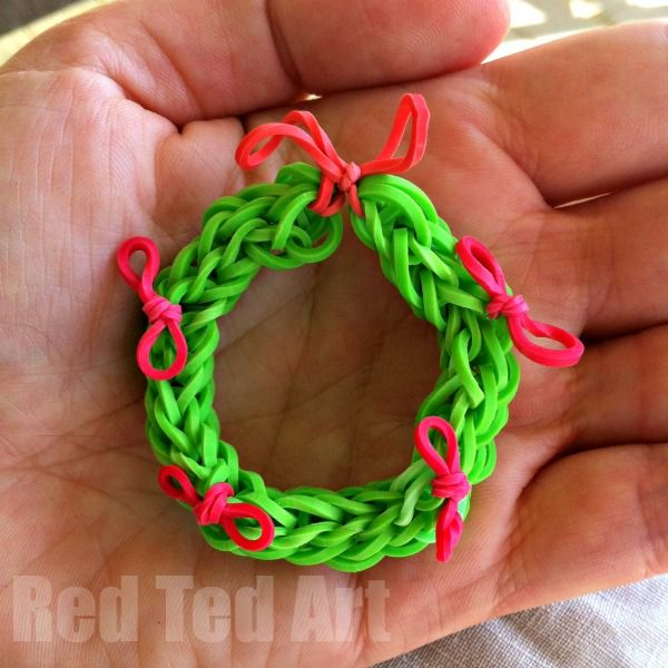"""During the Summer holidays, when we were in the middle of our """"Rainbow Loom"""" fever, teh kids and I came up with this super cute and simple Rainbow Loom Wreath idea – it works great as a Christmas Wreath ornament and is even cuter on our Fairy Door as a Christmas decoration. As we like …"""