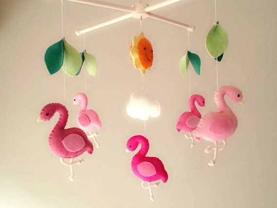 ((( INCLUDES )))  This nursery mobile contains 5 flamingos, 1 sun, 1 cloud and leaves. They are suspended from a green wood hanger, about 13 x 13.  This
