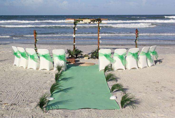 Natalia Wide sided bamboo wedding arch in green and white at beach wedding in New Smyrna Beach, Florida. Destination Wedding.