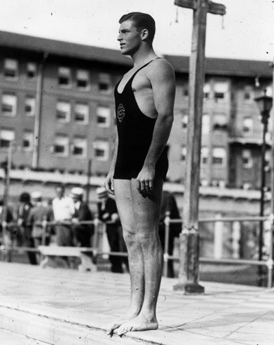 """Raised on a pineapple plantation in Hawaii, Clarence """"Buster"""" Crabbe '32 won the gold and also set an Olympic record in the 400-meter freestyle swim in Los Angeles in 1932. He later became known as """"King of the Serials"""" for his starring roles as Tarzan, Flash Gordon and Buck Rogers."""