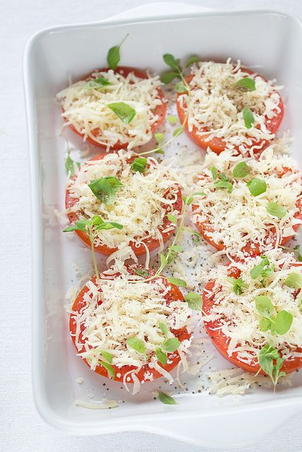 2 medium tomatoes 1/3 cup (50g) freshly grated Parmesan fresh oregano salt freshly ground pepper olive oil