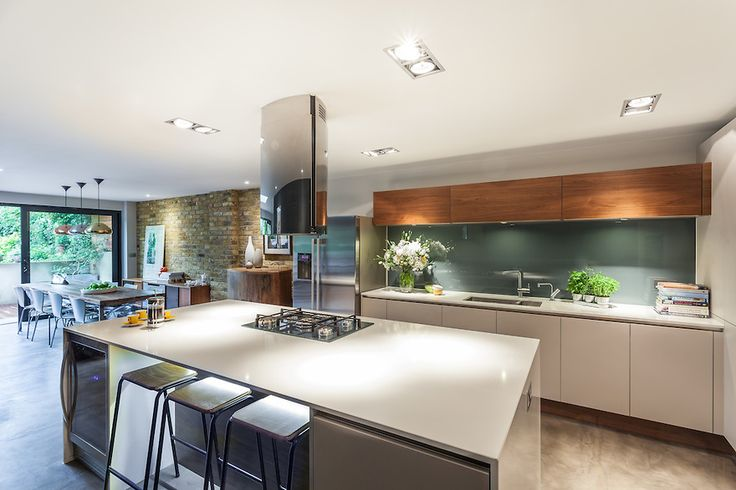 LED lighting under island. Grey concrete floor. Coloured splash back.  Simon Maxwell Photography