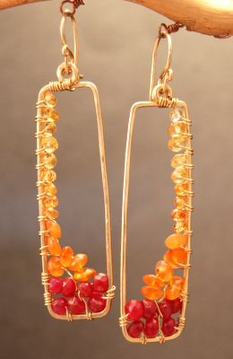 Loving these colours!Carnelian, orange sapphire, ruby, and gold wire-wrapped finished earrings