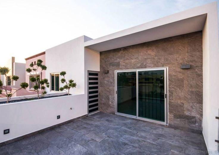 Casa AT: Terrazas de estilo translation missing: mx.style.terrazas.moderno por Cenit Arquitectos