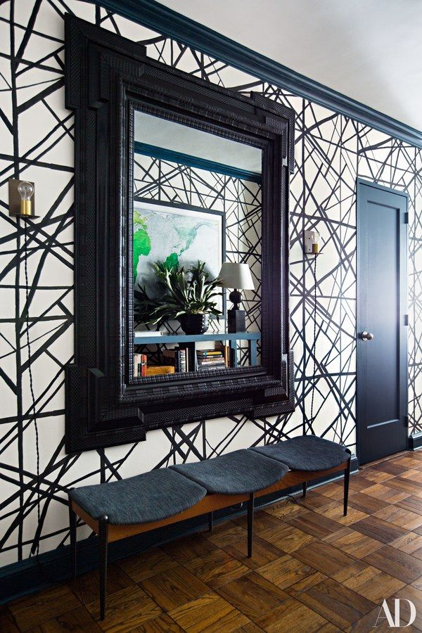 One of the few truly antique pieces in the apartment is this ebonized 1800s Dutch-style mirror near the entrance, purchased at Sibyl Colefax & John Fowler in London. A graphic ebony-and-ivory wallpaper by Kelly Wearstler brings the feel of the space right back to the present.