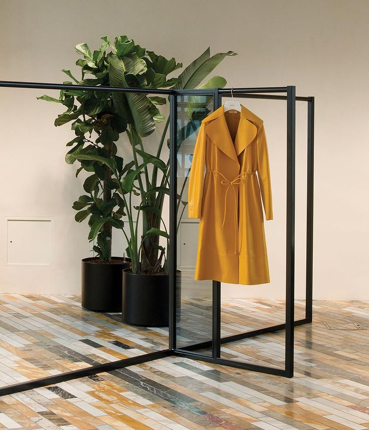 <strong>FRESH COAT</strong> | A coat from the spring 2015 collection hangs in the main showroom.
