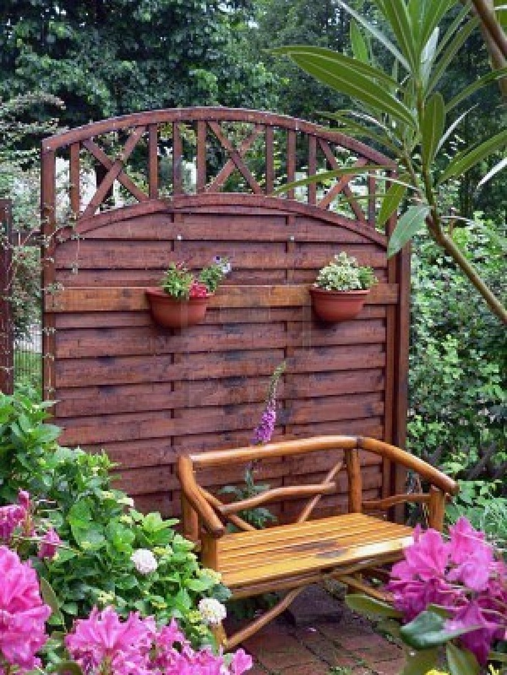 Country Garden, i like the idea of just a small space in a large garden, not the whole big fence.