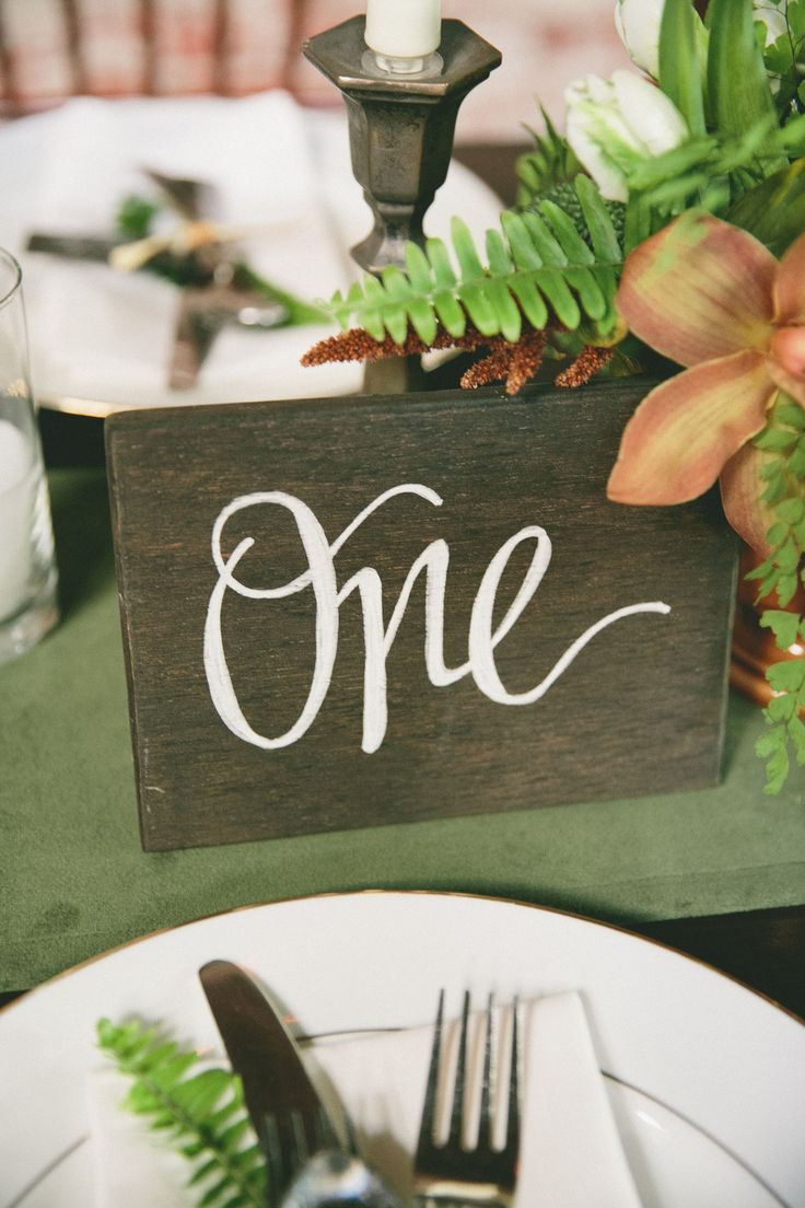 Wooden plank calligraphy numbers. Tessa Shane. Photography: onelove photography - onelove-photo.com  Read More: http://www.stylemepretty.com/2014/02/28/botanical-inspired-wedding-at-marvimon/