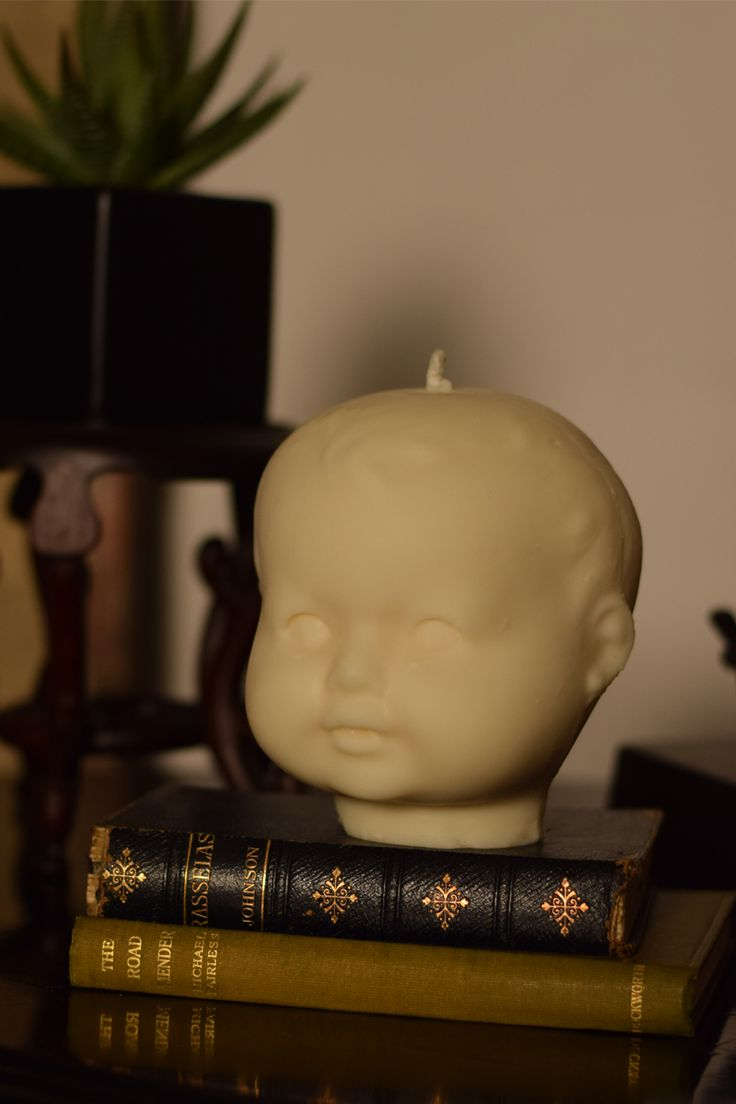 Large dolls head candle, fabulous and creepy . We love these at FIG .    Makes a great gift.    Made from a unique and handmade mould.Hand made in Brighton    Made from carbon neutral biodegradable, paraben free, rapeseed wax    Little Tim is 13cm x 13c
