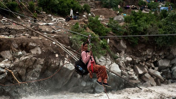 A stranded Indian pilgrim is transported across a river using a rope rescue system by Indo-Tibetan Border Police (ITBP) personnel in Govind Ghat on 23 June 2013 Posted by floodlist.com #Uttarakhand #Floods