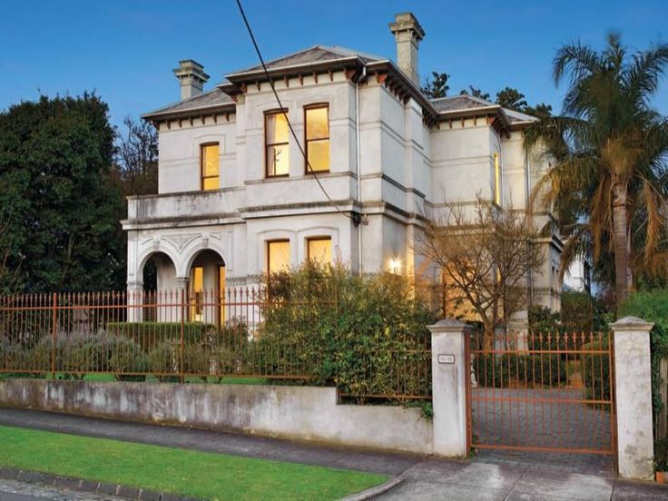 Photo of a concrete victorian house exterior with sash windows & landscaped garden - House Facade photo 525341. Browse hundreds of images of victorian house exteriors & photos of concrete in facade designs.