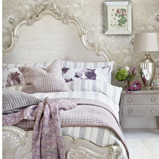This lavender and silver bedroom is so pretty. Don't be afraid to mix patterns, just be smart about it!
