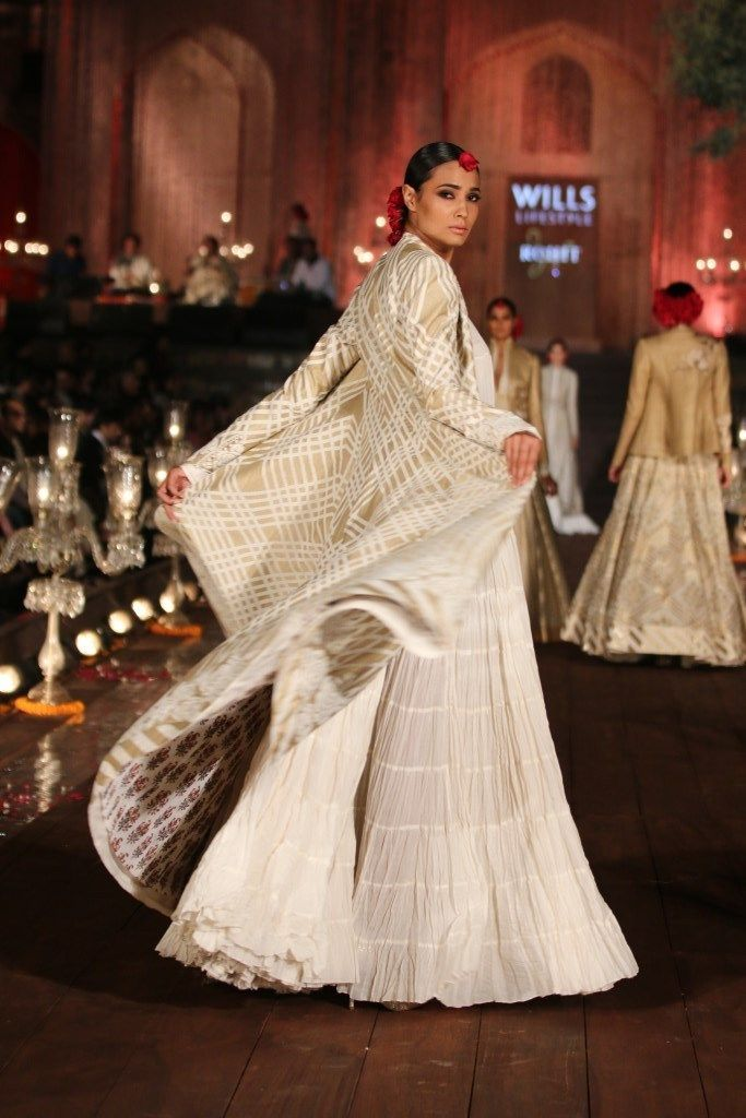 White and gold coat over a lengha | JJ Valaya Garden of Flowers Fashion Runway Collection